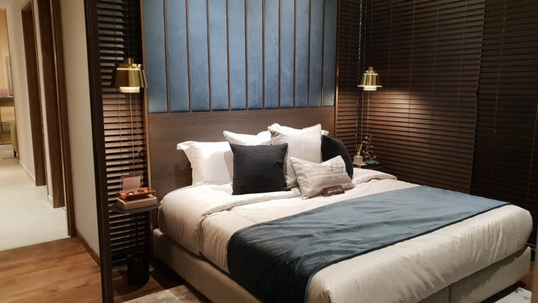 A bedside lamp or night light is good for sleep interruptions.  Limiting exposure to light will help you go back to sleep